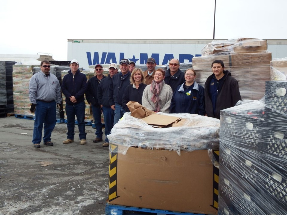 Devon and Walmart employees and Christian Food Storehouse Director Cinde Pfisterer with pallets of food items ready for transport to the Christian Food Storehouse in Riverton.