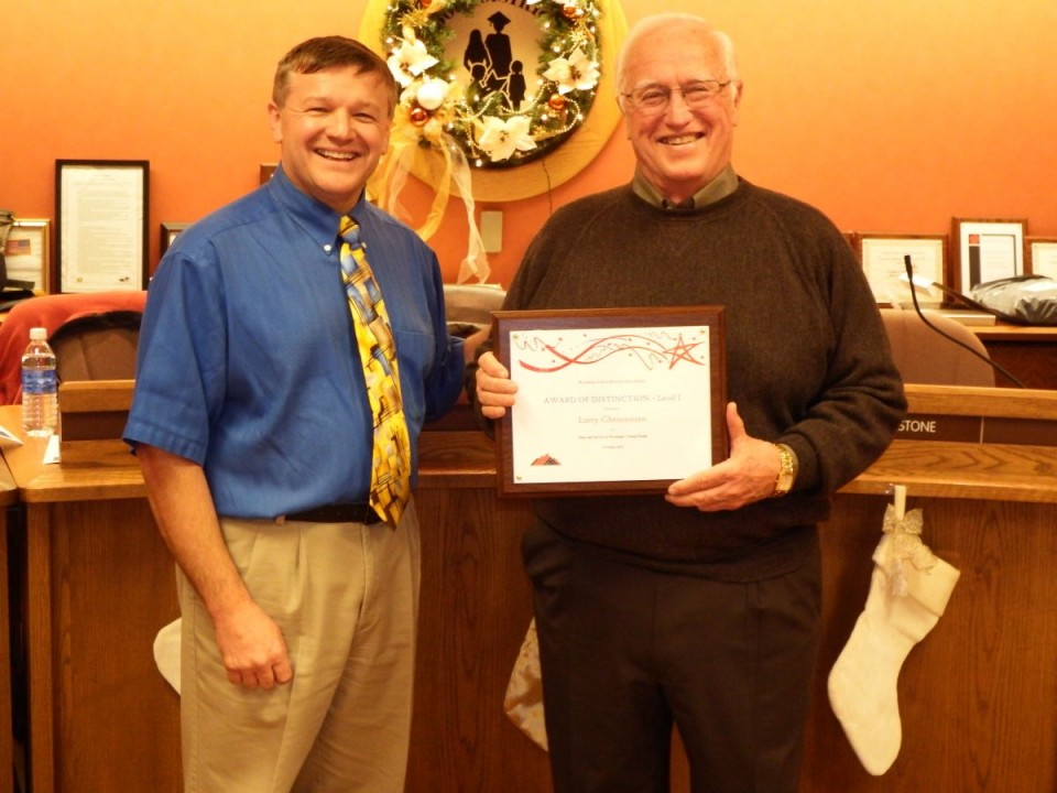 Outgoing Board Chairman Larry Christensen recieved an Award of Distinction from the Wyoming School Boards Association. It was presented by incoming chairman Dean Peranteaux.
