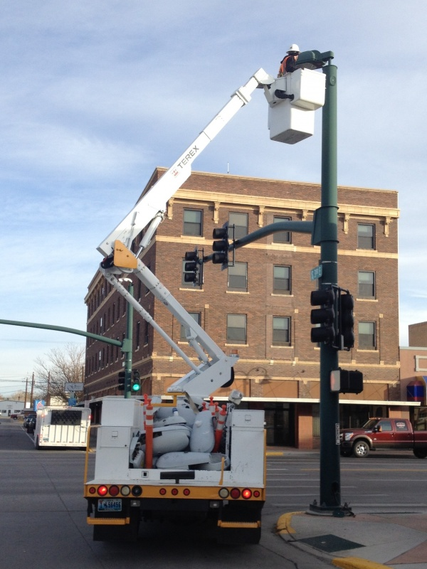 Replacing street light bulbs at East Main and Third East in Riverton.