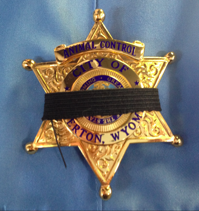 All Riverton Police Officers are wearing a black band around their respective badges in honor of Carolyn Whitman, the RPD's Investigative Technician, who died on Friday of injuries sustained when her car was hit be an alleged drunk driver.