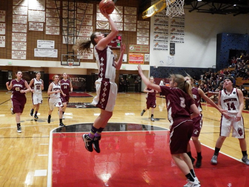 Kiley Ridgway goes up for two against Laramie Friday night at the Bill Strannigan East/West Challenge at Wolverine Gym.
