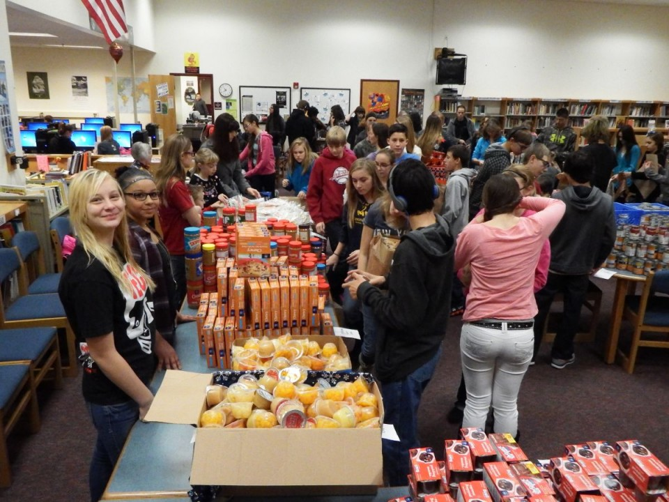 RMS and community volunteers helped stuff over 200 food bags in the Food For Break program this morning at Riverton Middle School.