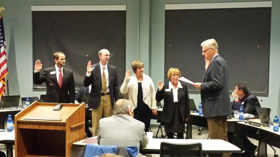 Sworn into office were, from left, Dr. John Mercer, Steven Peck, Nicole Schoening and Mickey Douglas. (CWC Photo)