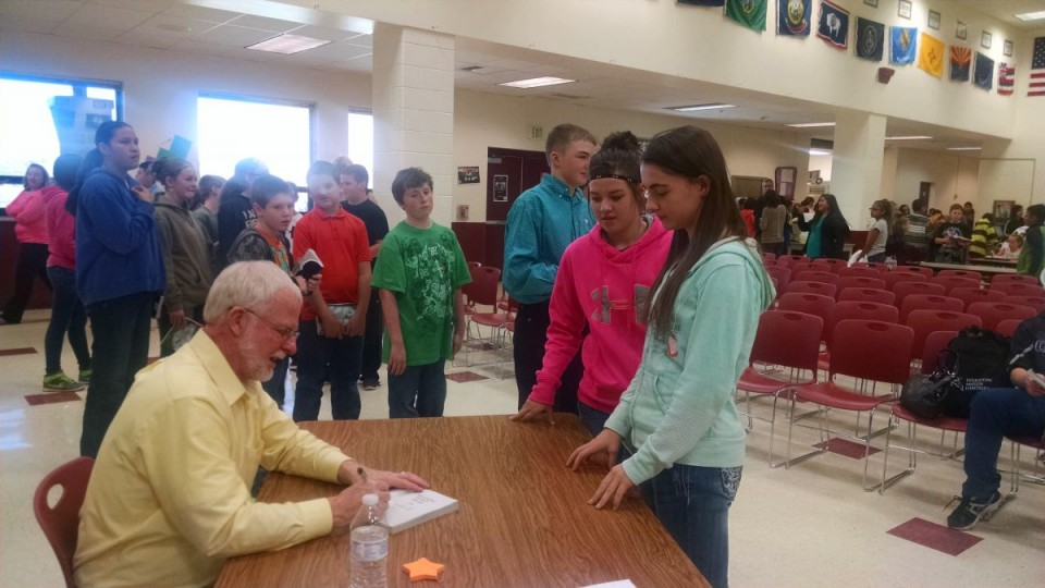 WRMS students Gaby Wall and Madison Enos having their books signed by author Ben Mikaelsen following a reading in Riverton. (WRMS photo)