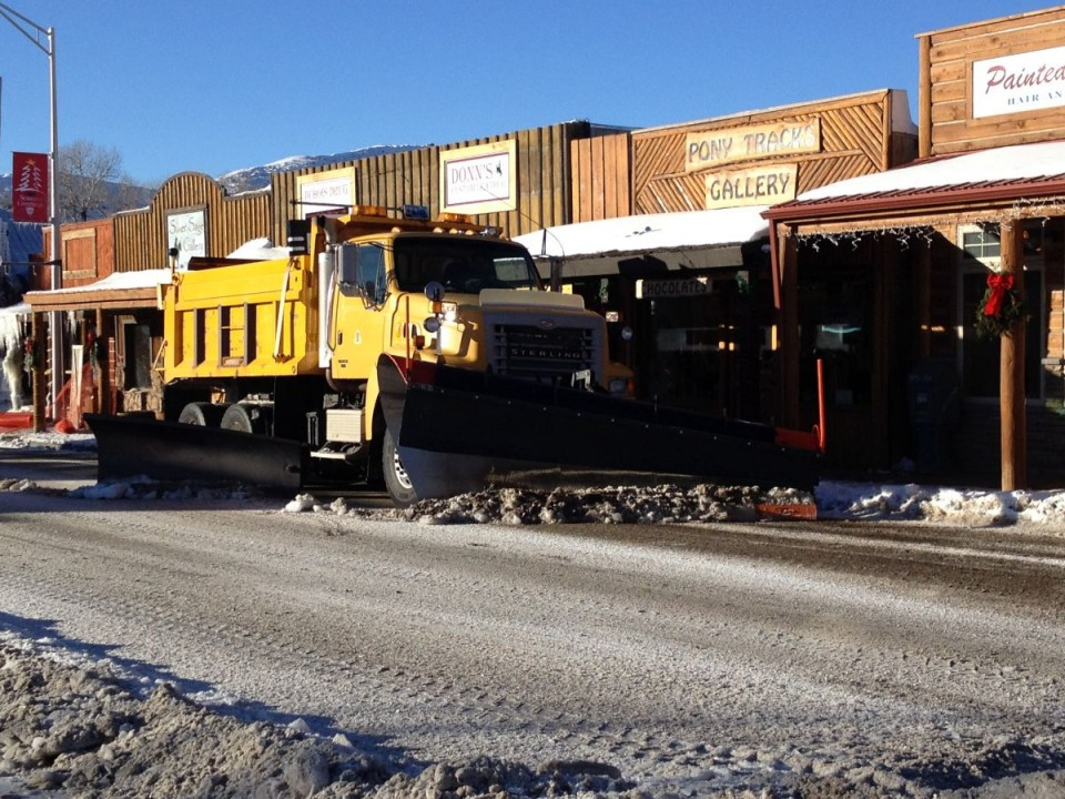 A WYDOT snow plow cleared ice from Downtown Dubois after Tuesday's fire.