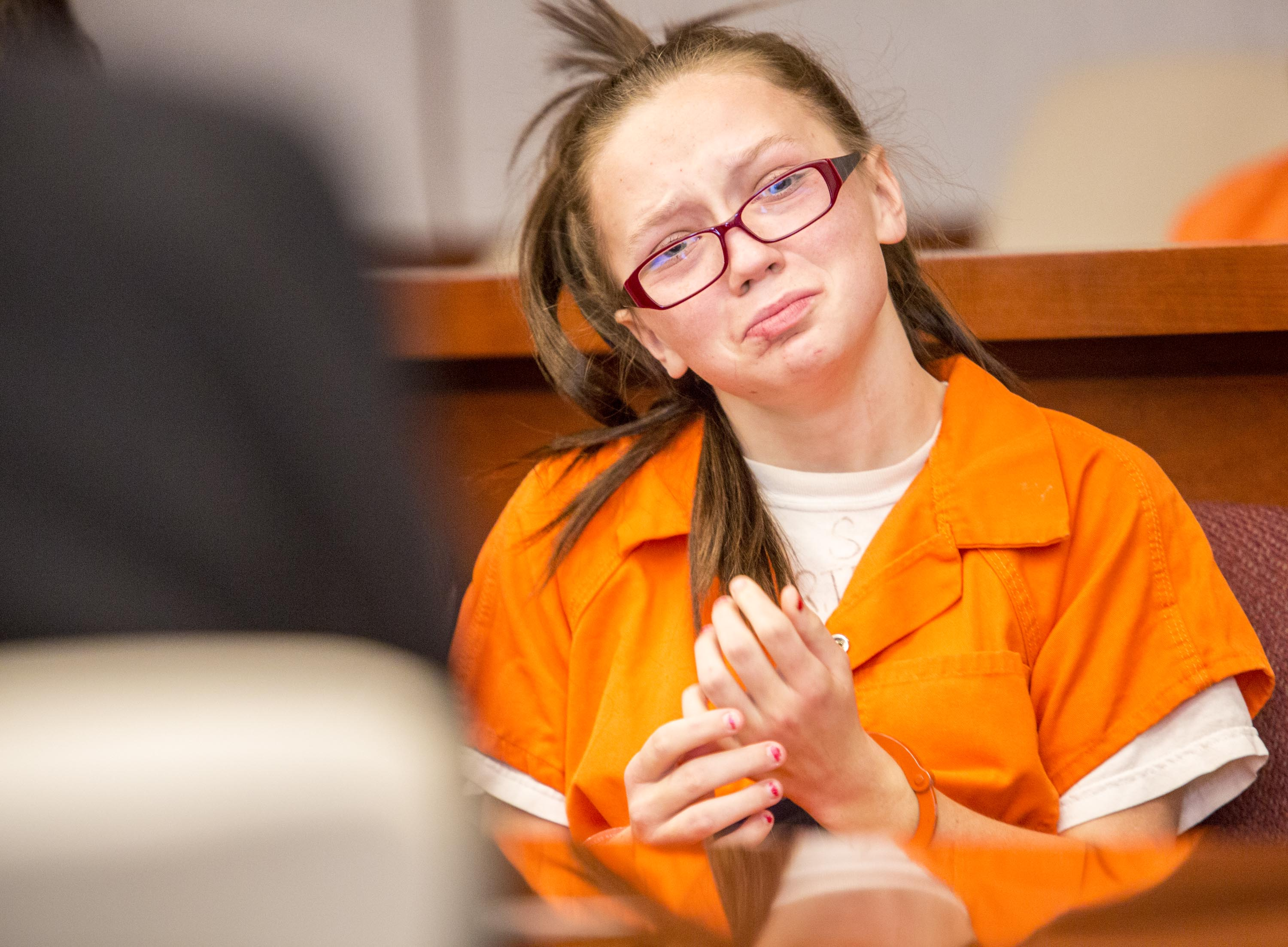 Jessica Carnline, 17, waits for the initial hearing in her case where she is charged with two counts of aggravated vehicular homicide.
